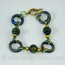 Orphanage 1. Polymer clay, color-changing mood beads, aluminum toggle clasp.