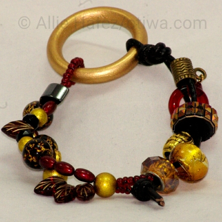 The Color of Gold. Pewter, crystals, leather, brass. Simple button loop clasp.